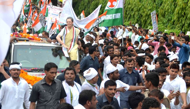 Congress chief Sonia Gandhi during a roadshow in Varanasi on Aug 2, 2016. - Sonia Gandhi