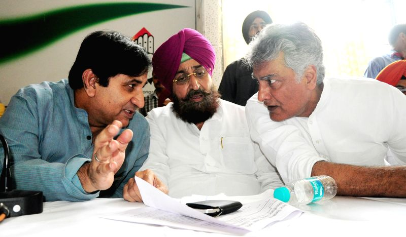 Congress General Secretary and in-charge of Punjab affairs Shakeel Ahmed, Punjab Congress President Partap Singh Bajwa during a programme in Chandigarh on July 15, 2014. - Partap Singh Bajwa