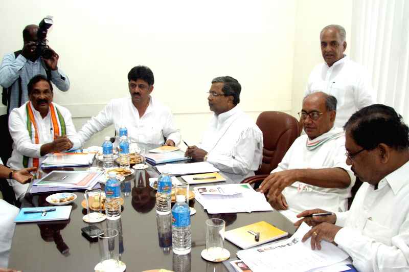 Congress General Secretary Digvijaya Singh, Karnataka Chief Minister and Congress leader Siddaramaiah, Karnataka Congress chief G. Parameshwara and others during a party meeting in Bangalore on Aug ..