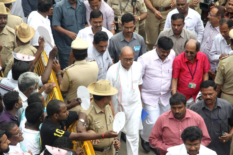 Congress General Secretary Digvijaya Singh arrives to attend a party meeting in Bangalore on Aug 26, 2014.