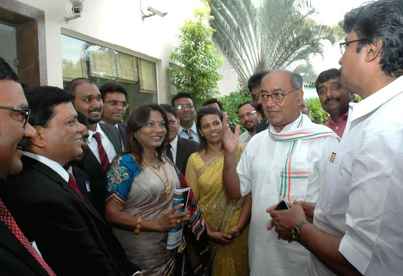 Congress General Secretary Digvijaya Singh with President of DICCI, Padmashree Milind Kamble during a programme organised by Dalit Indian Chamber and Industries -Karnataka chapter in Bangalore on Aug