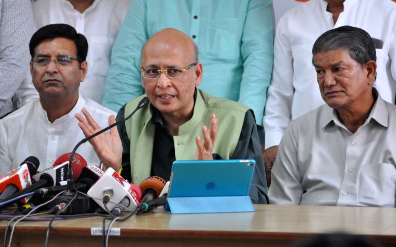 Congress leader Abhishek Manu Singhvi addresses a press conference in Dehradun on May 26, 2017.