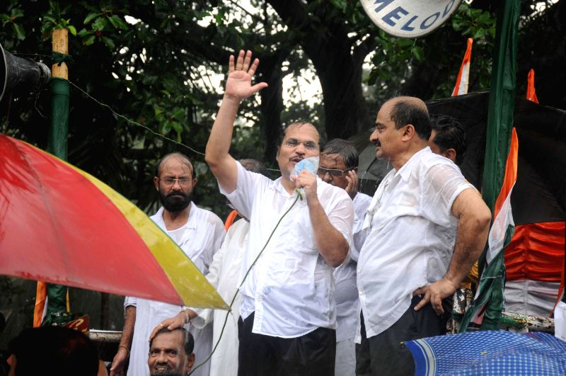Congress leader Adhir Ranjan Chowdhury addresses party workers protest rally against West Bengal government and Central government amidst rains in Kolkata on June 25, 2014.