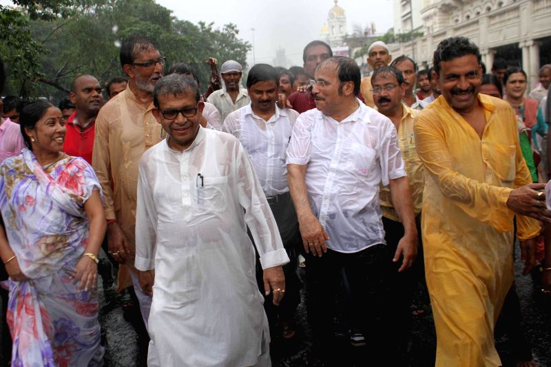 Congress leader Adhir Ranjan Chowdhury, Manas Bhunia and others participate in a protest rally against West Bengal government and Central government amidst rains in Kolkata on June 25, 2014.