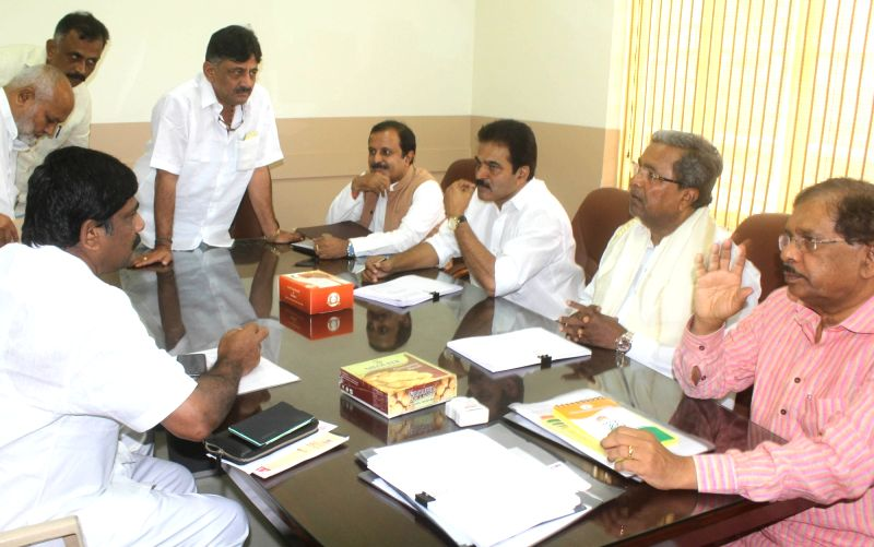 Congress leader and Karnataka Chief Minister Siddaramaiah with K. C. Venugopal, G. Parameshwara, D. K. Shivakumar during a party meeting in Bengaluru on May 25, 2017. - Siddaramaiah