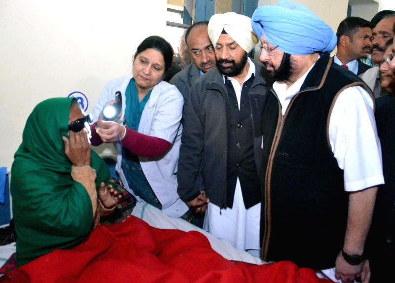 Congress leader and MP from Amritsar Captain Amarinder Singh meeting with the patients who lost their eyesight during an eye camp held at Ghuman in Gurdaspur village on Dec. 13, 2014.