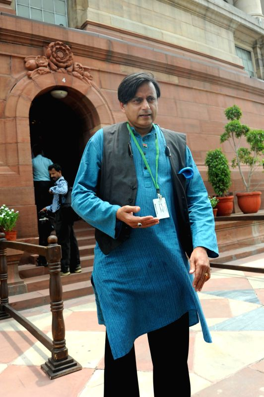 Congress leader and Thiruvananthapuram MP Shashi Tharoor comes out of the Parliament after attending budget session of the house in New Delhi on July 14, 2014. - Shashi Tharoor