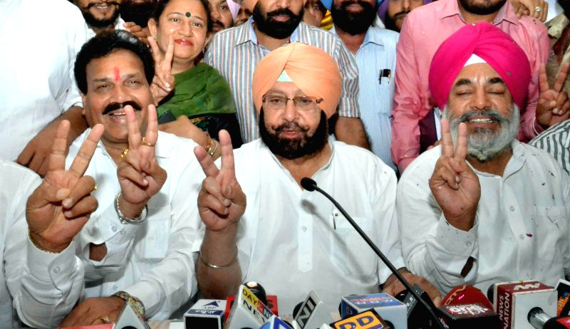 Congress leader Captain Amarinder Singh addresses a press conference after winning Amritsar Lok Sabha Seat in Amritsar on May 16, 2014.