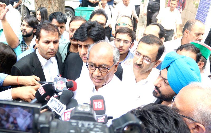 Congress leader Digvijay Singh talks to press at Patiala House Court in New Delhi, on May 29, 2017. - Digvijay Singh
