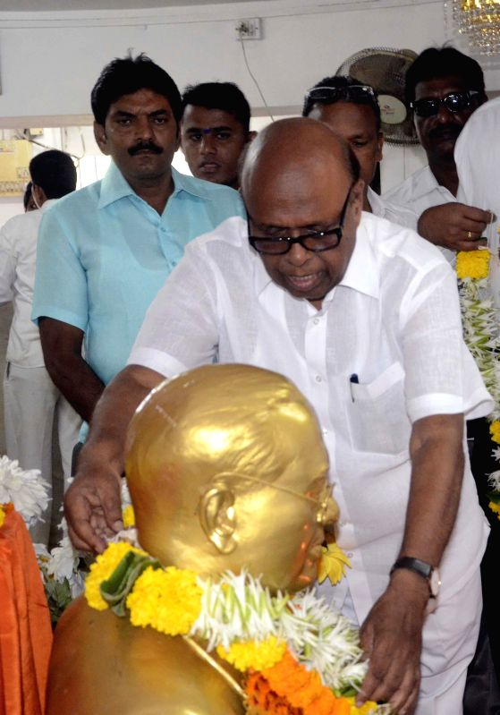 Congress leader Eknath Gaikwad pay tribute to Dr. BR Ambedkar on his birth anniversary at Chaitya Bhoomi in Mumbai on April 14, 2014.
