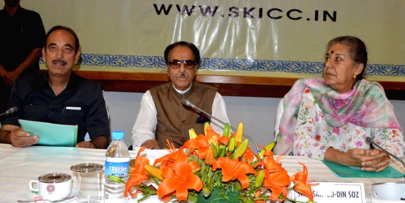 Congress leader Ghulam Nabi Azad, Ambika Soni, and Jammu and Kashmir Pradesh Congress Committee chief Saif-ud-Din Soz during a meeting at Sher-i-Kashmir International Conference Centre (SKICC) in ...