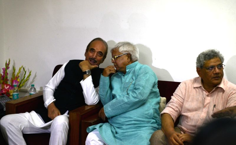 Congress leader Ghulam Nabi Azad interacts with RJD chief Lalu Prasad during a meeting of opposition parties at Parliament House in New Delhi on June 14, 2017. Also seen CPI-M General ... - Sitaram Yechury