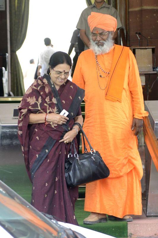 Congress leader Girija Vyas and BJP MP Sakshi Maharaj at Parliament in New Delhi on May 9, 2016.