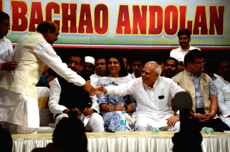 "Congress leader Kapil Sibal greets party leader Manikrao Thakre during ""Bharat Bachao Andolan"", in Mumbai on July 21, 2018."