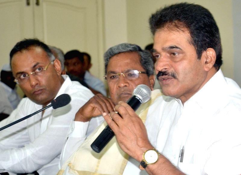 Congress leader KC Venugopal addresses a press conference in Bengaluru on May 25, 2017. Also seen Karnataka Chief Minister Siddaramaiah, G. Parameshwara and others. - Siddaramaiah