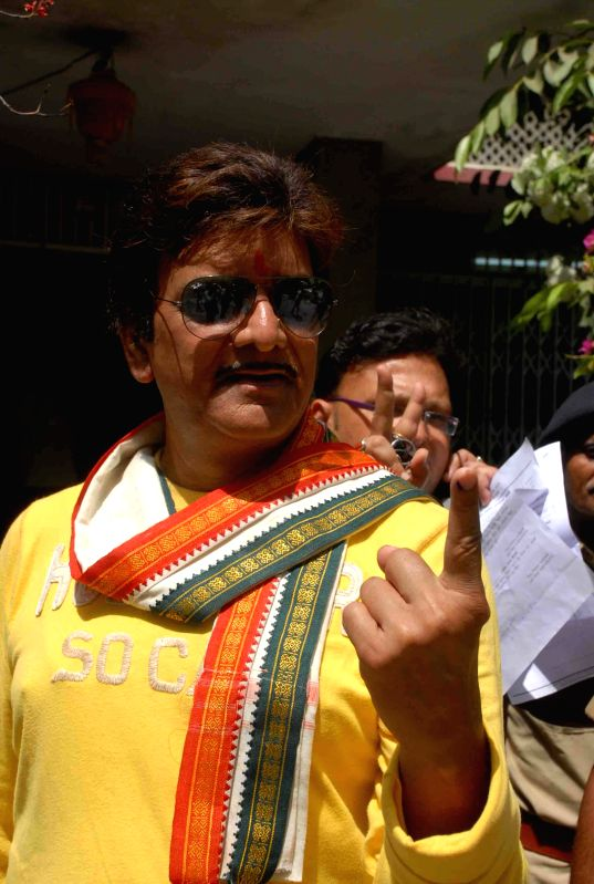 Congress leader Kunal Singh shows his fore finger marked with phosphoric ink after casting his vote during the fifth phase of 2014 Lok Sabha Polls in Patna on April 17, 2014.