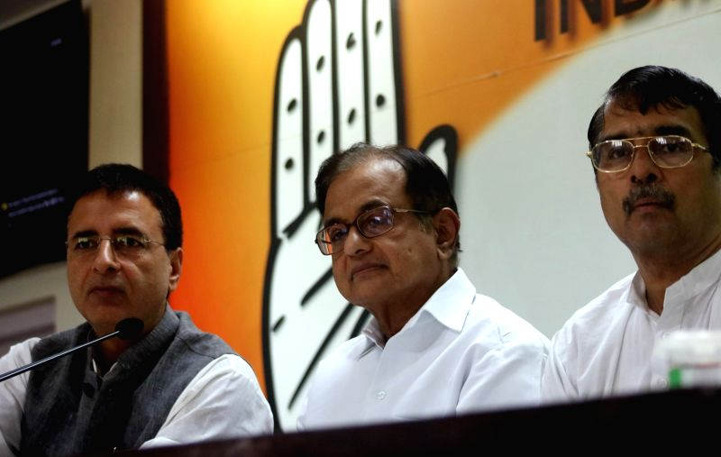 Congress leader P Chidambaram addresses during a press conference in New Delhi on May 28, 2016. Also seen Congress leader Randeep Singh Surjewala. - Randeep Singh Surjewala