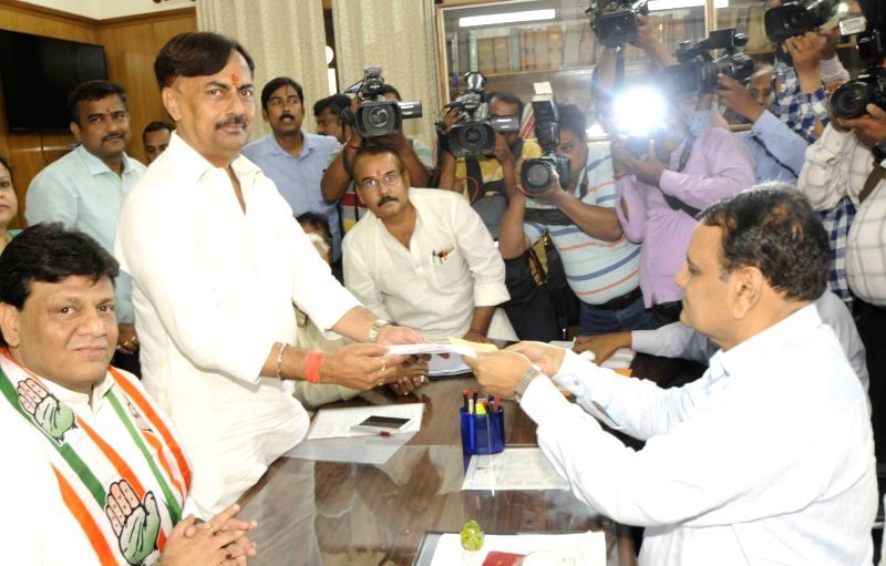 Congress leader Premchand Mishra files nomination papers for upcoming for Bihar Legislative Council elections in Patna, on April 16, 2018. - Premchand Mishra