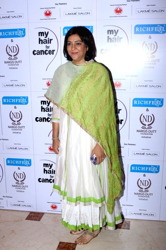 Congress leader Priya Dutt during the social cause campaign 'My Hair for Cancer' organised by Hair care brand Richfeel and Nargis Dutt Foundation in Mumbai on April 18, 2017. - Priya Dutt and Nargis Dutt Foundation