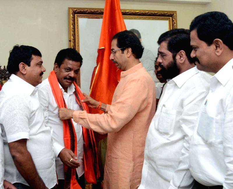 Congress leader Ravindra Phatak joins Shivsena in presence of party chief Uddhav Thackeray in Mumbai on July 19, 2014.