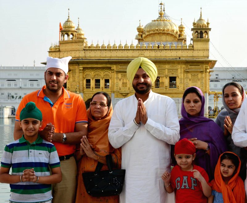 Congress leader Ravneet Singh Bittu pays obeisance at the Golden Temple after winning Ludhiana Lok Sabha, in Amritsar on May 17, 2014.