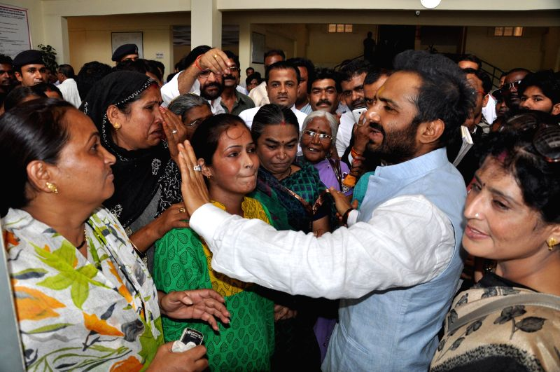 Congress leader Sanjeev Saxena with his family members before being arrested by Special Task Force in Bhopal on May 12, 2014.
