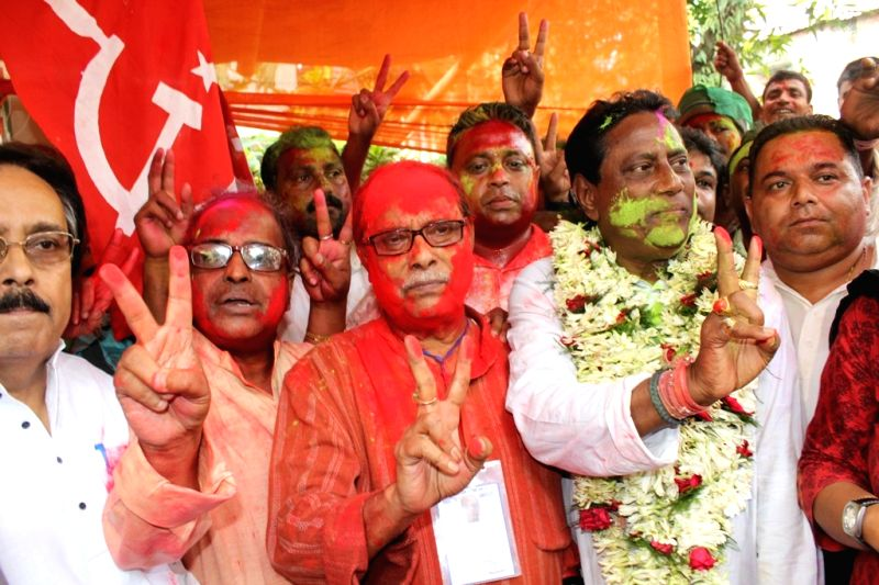Congress leader Shankar Malakar and Asok Bhattacharya of CPI-M celebrate latters victory from Siliguri Assembly constituency in the recently concluded 2016 West Bengal Assembly polls in ...