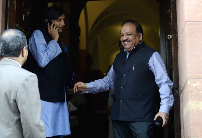 Congress leader Shashi Tharoor and Union Minister for Science and Technology and Earth Sciences Dr. Harsh Vardhan at the Parliament House in New Delhi, on Dec 8, 2015. - Shashi Tharoor