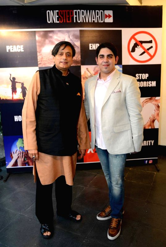 Congress leader Shashi Tharoor during inauguration of  Armaan Malhotra's art exhibition in New Delhi, on May 23, 2016. - Shashi Tharoor and Armaan Malhotra