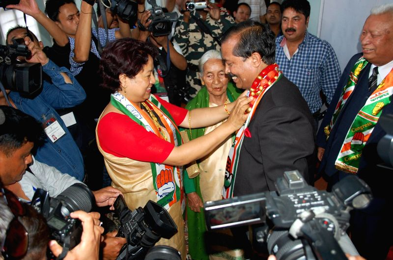 Congress leader Vincent H Pala with his wife after winning Shillong Lok Sabha seat in Shillong on May 16, 2014.