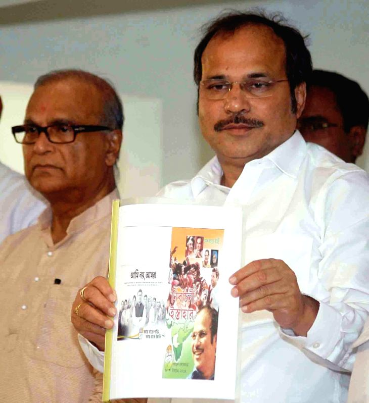 Congress leaders Adhir Ranjan Chowdhury and West Bengal Congress President Pradip Bhattcharya release party's manifesto in Kolkata on April 15, 2014.
