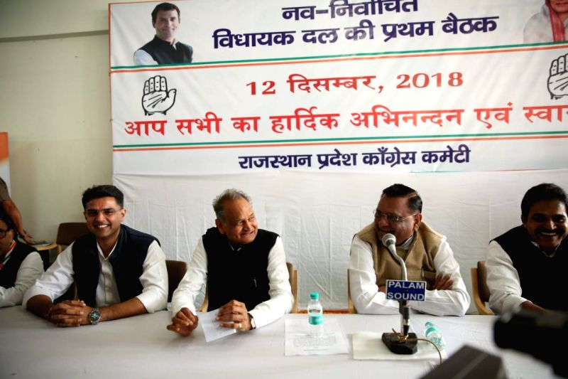 Congress leaders Ashok Gehlot, Sachin Pilot with newly elected MLAs at Congress legislature party meeting in Jaipur on Dec. 12, 2018.