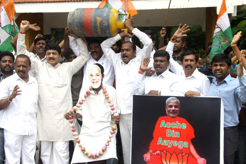 Congress leaders demonstrate against hike in LPG prices at Seshadripuram in Bangalore on July 2, 2014.