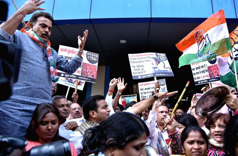 Congress leaders led by party's Mumbai chief Sanjay Nirupam participate in a demonstration against petrol, diesel and cooking gas cylinder price hike in Mumbai on Jan 30, 2018.