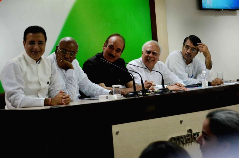 Congress leaders Mallikarjun Kharge, Ghulam Nabi Azad, Kapil Sibal and Randeep Singh Surjewala address a press conference in New Delhi, on May 26, 2016. - Randeep Singh Surjewala