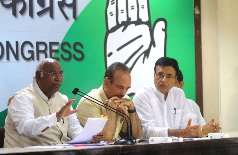 Congress leaders Mallikarjun Kharge, Ghulam Nabi Azad and Randeep Singh Surjewala during a press conference, in New Delhi on July 17, 2018. - Randeep Singh Surjewala