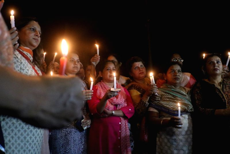 Congress leaders participate in a candlelight vigil called by party president Rahul Gandhi to protest against incidents of rape in Unnao (Uttar Pradesh) and Kathua (Jammu and Kashmir) at ... - Rahul Gandhi