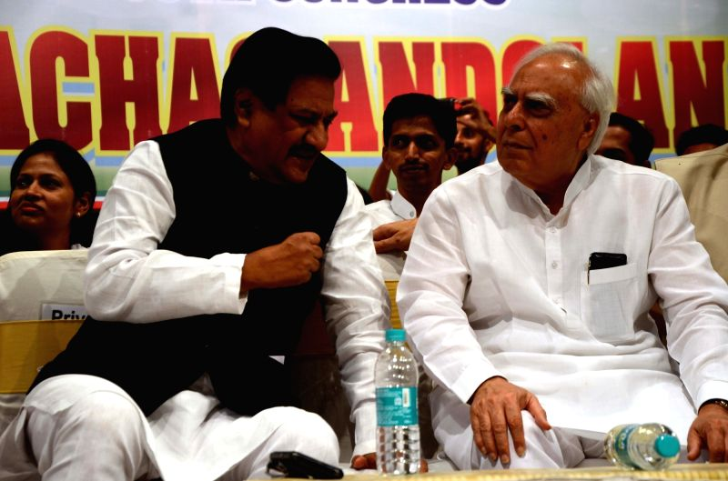 "Congress leaders Prithviraj Chavan in a conversation with Kapil Sibal during ""Bharat Bachao Andolan"", in Mumbai on July 21, 2018."