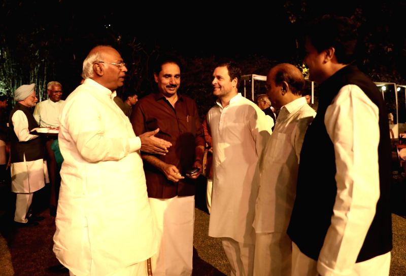 Congress leaders Rahul Gandhi, Mallikarjun Kharge, AK Antony and Revolutionary Socialist Party's N. K. Premachandran during a dinner hosted by UPA Chairperson Sonia Gandhi at her residence ... - Rahul Gandhi and Sonia Gandhi