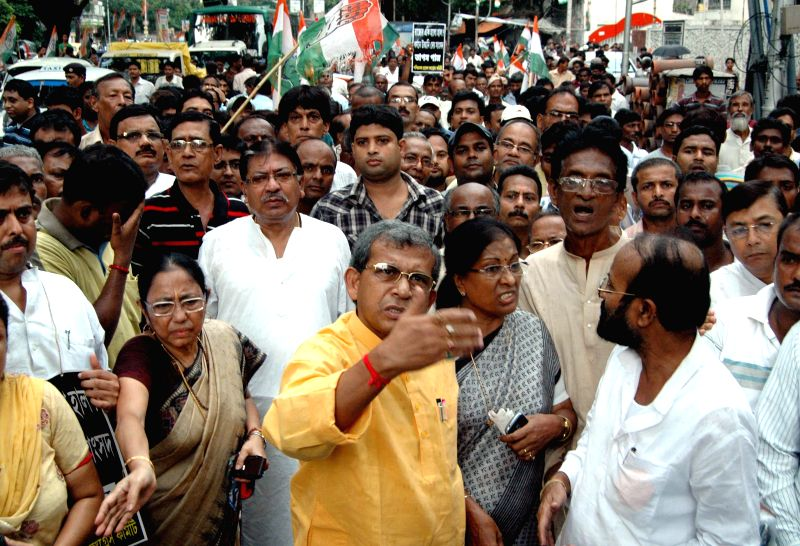 Congress leaders Somen Mitra , Manas Bhunia and others participate in a rally against Mamata Banerjee-led West Bengal government and Krishnanagar MP and Trinamool Congress leader Tapas Paul who was .. - Mamata Banerjee