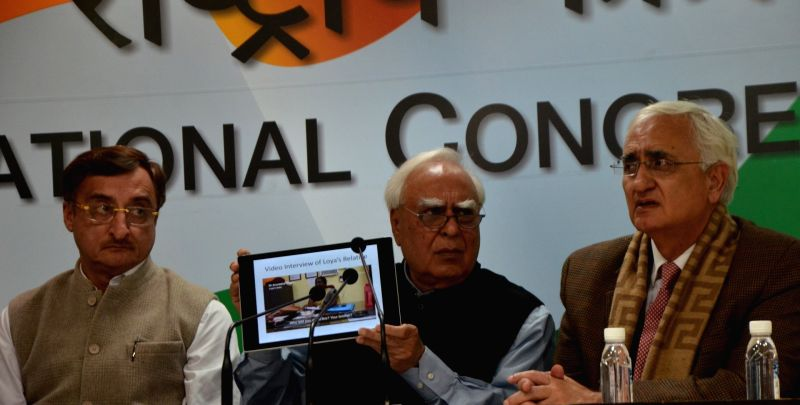 Congress leaders Vivek Tankha, Kapil Sibal and Salman Khurshid during a press conference in New Delhi on Jan 31, 2018.