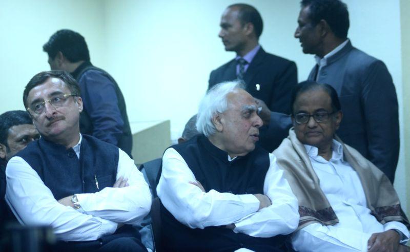 Congress leaders Vivek Tankha, P. Chidambaram and Kapil Sibal during party chief Rahul Gandhi's press conference in New Delhi, on Jan 12, 2018. - Rahul Gandhi
