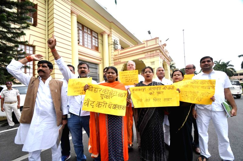 Congress legislators stage a demonstration against the alleged rape-murders of inmates of a girls' home in Muzaffarpur; at Bihar Legislative Assembly in Patna on July 24, 2018.