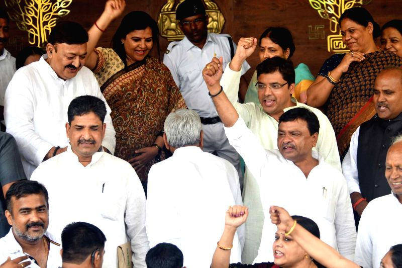 Congress legislators stage a demonstration as Bihar Chief Minister and JD-U legislator Nitish Kumar arrives at the state assembly, in Patna on July 24, 2018. - Nitish Kumar