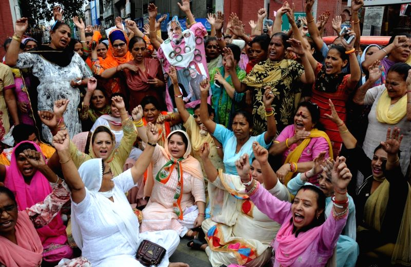 "Congress Mahila Morcha workers stage a demonstration against Prime Minister Narendra Modi and Pakistan after an Army soldier and a BSF trooper were killed and ""mutilated"" on the ... - Narendra Modi"