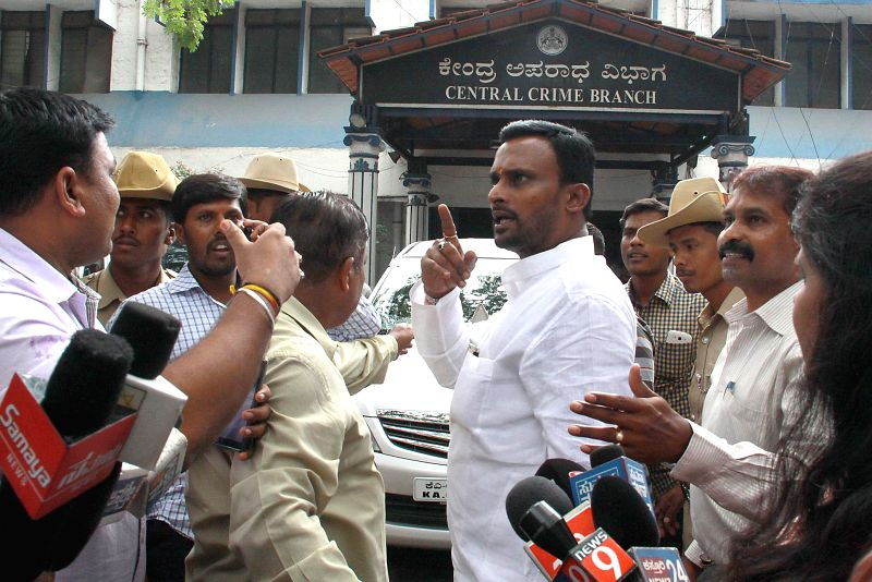 Congress MLA Vijayanand Kashappanavar talks to press at Central Crime Branch (CCB) office in Bangalore on July 7, 2014.