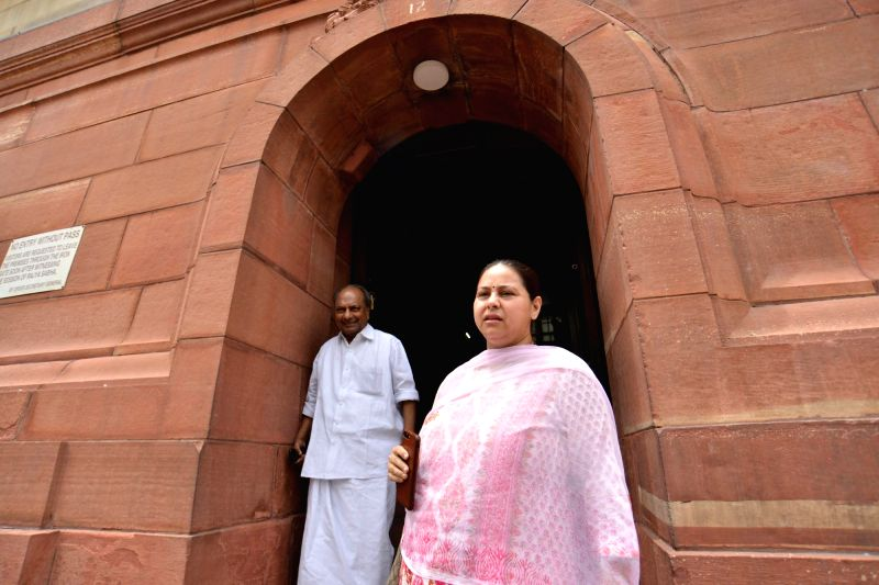 Congress MP A. K. Antony and RJD MP Misa Bharti at Parliament in New Delhi on Aug 3, 2018.