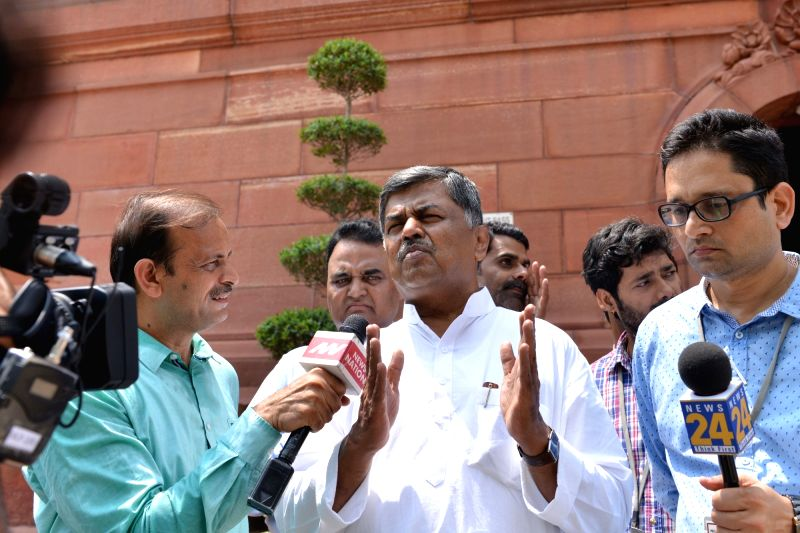 Congress MP B. K. Hariprasad talks to the media at Parliament, in New Delhi on Aug 9, 2018. B.K. Hariprasad was fielded by opposition parties as UPA's candidate in the Rajya Sabha Deputy ... - Harivansh Narayan Singh