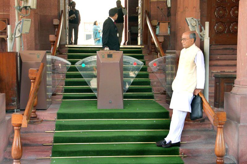 Congress MP Digvijay Singh at the Parliament premises in New Delhi, on Dec 1, 2014. - Digvijay Singh