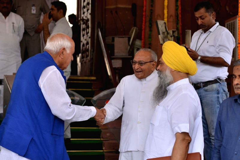 Congress MP Motilal Vora and National Conference MP Farooq Abdullah at Parliament, in New Delhi on Aug 1, 2018.